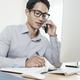 Entrepreneur writing in planner - PhotoDune Item for Sale