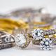 Engagement diamond wedding ring group on white background, diamond, golden rings - PhotoDune Item for Sale