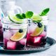 Blueberry Mojito with lime and fresh mint. Iced cold summer drink in glass jar. - PhotoDune Item for Sale