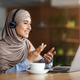 Young woman in hijab having video conference at cafe - PhotoDune Item for Sale