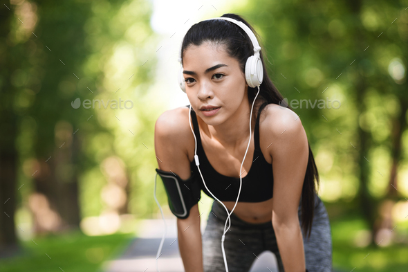 Portrait Of Tired Asian Jogger Girl Taking Breath After Jogging In Park - Stock Photo - Images