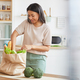Smiling Woman Unpacking Groceries in Kitchen - PhotoDune Item for Sale
