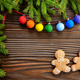 Christmas background of gingerbread cookies spruce branches and colorful balls on wooden table - PhotoDune Item for Sale