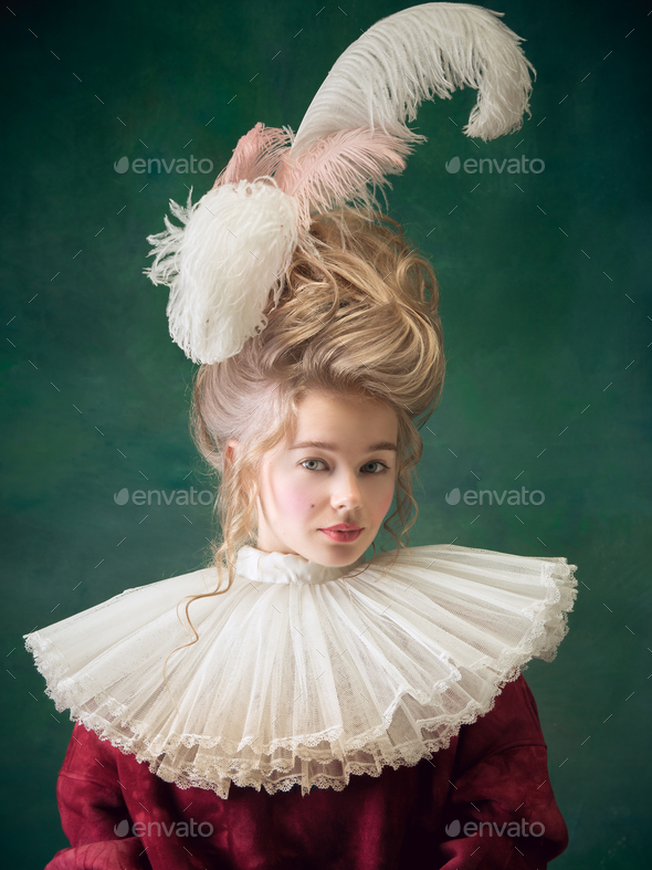 Young woman as Marie Antoinette on dark background. Retro style, comparison of eras concept - Stock Photo - Images