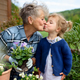 Senior grandmother with small granddaughter gardening on balcony in summer - PhotoDune Item for Sale