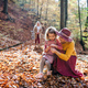 Small girl with mother and grandmother on a walk in autumn forest - PhotoDune Item for Sale