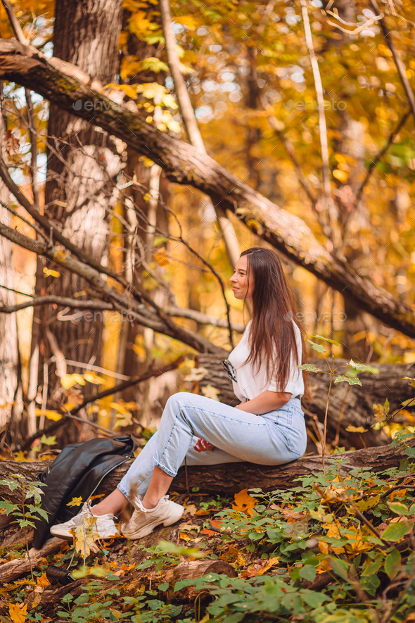 Fall concept - beautiful woman in autumn park under fall foliage - Stock Photo - Images