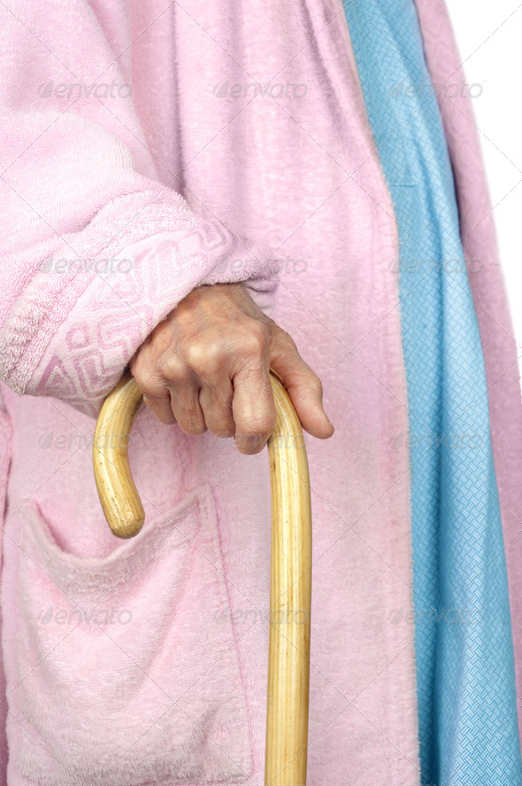 Elderly woman walking with cane - Stock Photo - Images
