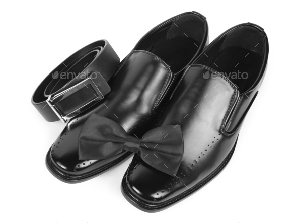 Close up of black male shoes, bow tie and belt - Stock Photo - Images