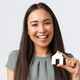 Insurance, loan, real estate and family concept. Close-up of smiling beautiful asian woman buying - PhotoDune Item for Sale