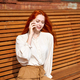 Red-haired woman talking on cell phone. Beautiful stylish fashion model - PhotoDune Item for Sale