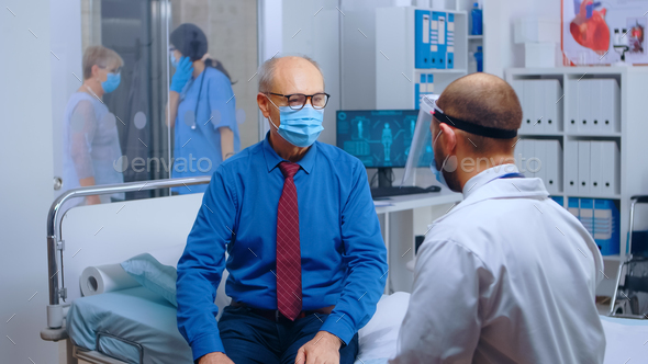 Senior patient wearing mask at doctor appointment - Stock Photo - Images