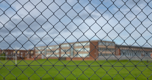 High School Building Behind A Fence - Stock Photo - Images