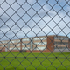 High School Building Behind A Fence - PhotoDune Item for Sale