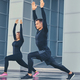 Fitness couple is stretching over modern building background. - PhotoDune Item for Sale