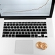 Two golden bitcoins placed on silver laptop with financial chart on its screen - PhotoDune Item for Sale