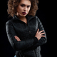 Confident curly girl wearing black jacket and blue jeans - PhotoDune Item for Sale
