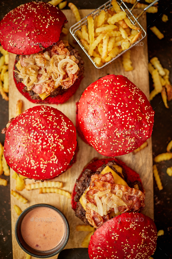 Burgers near sauce and french fries - Stock Photo - Images