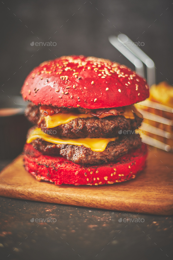 Delicious burger with red bun - Stock Photo - Images
