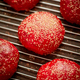 Fresh baked red homemade burger buns with sesame top view. Placed on metal grill - PhotoDune Item for Sale