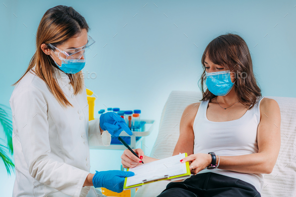 Nurse with Protective Mask Filling in Information Form. Blood Drawing and Analysis - Stock Photo - Images