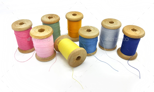 Spools of bright multi-colored threads on a white background - Stock Photo - Images