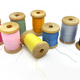 Spools of bright multi-colored threads on a white background - PhotoDune Item for Sale