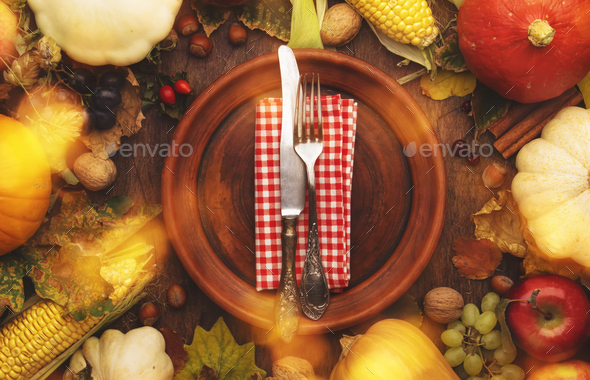 Thanksgiving day concept. Autumn background from fallen leaves and fruits with table setting - Stock Photo - Images