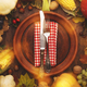 Thanksgiving day concept. Autumn background from fallen leaves and fruits with table setting - PhotoDune Item for Sale