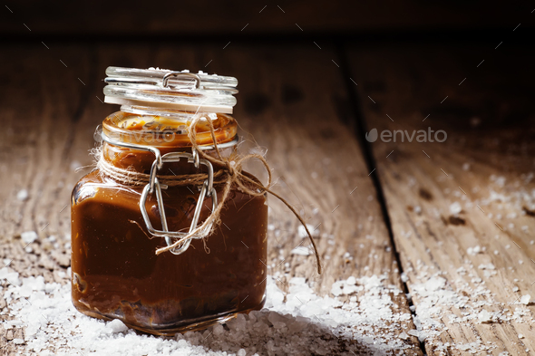 Salted caramel in a glass jar, selective focus - Stock Photo - Images
