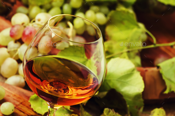 Cognac In Glass, Grapes And Vine, Vintage Wood Background, Selective Focus - Stock Photo - Images