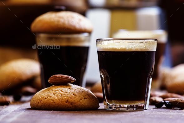 Espresso coffee, amaretti biscuits with almonds, neapolitan coffee maker - Stock Photo - Images