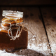 Salted caramel in a glass jar, selective focus - PhotoDune Item for Sale