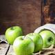 Green apples on vintage wooden background, selective focus - PhotoDune Item for Sale