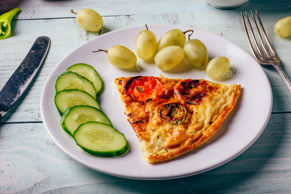 Breakfast frittata with sliced cucumber, and green grapes - Stock Photo - Images
