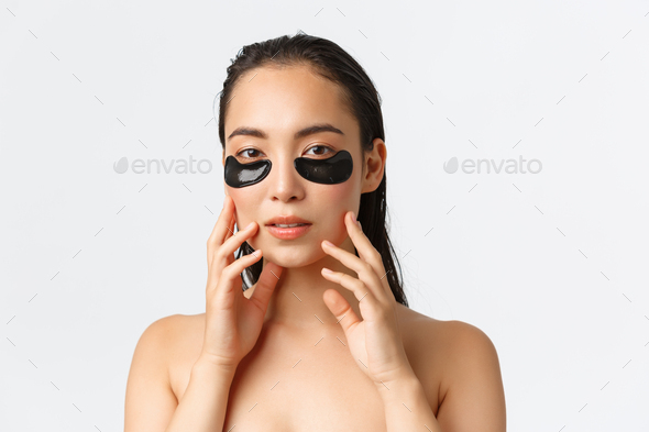 Skincare, women beauty, hygiene and personal care concept. Close-up of attractive asian female - Stock Photo - Images