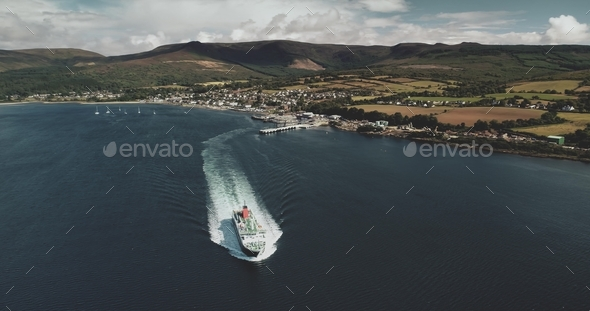Scotland's ocean, passenger ferry aerial view in coastal water of Firth-of-Clyde Gulf, Brodick - Stock Photo - Images