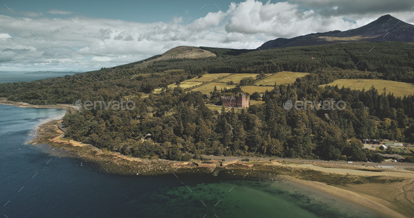 Scotland's Arran island landscape aerial zooming view: forests, meadows, mountains at summer day - Stock Photo - Images