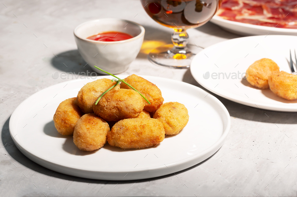 Tapas croquettes, traditional Spanish or French snack. Concrete background - Stock Photo - Images