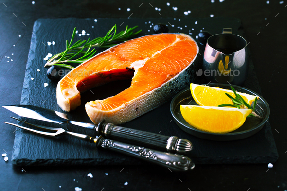 Raw salmon with lemon and spices - Stock Photo - Images