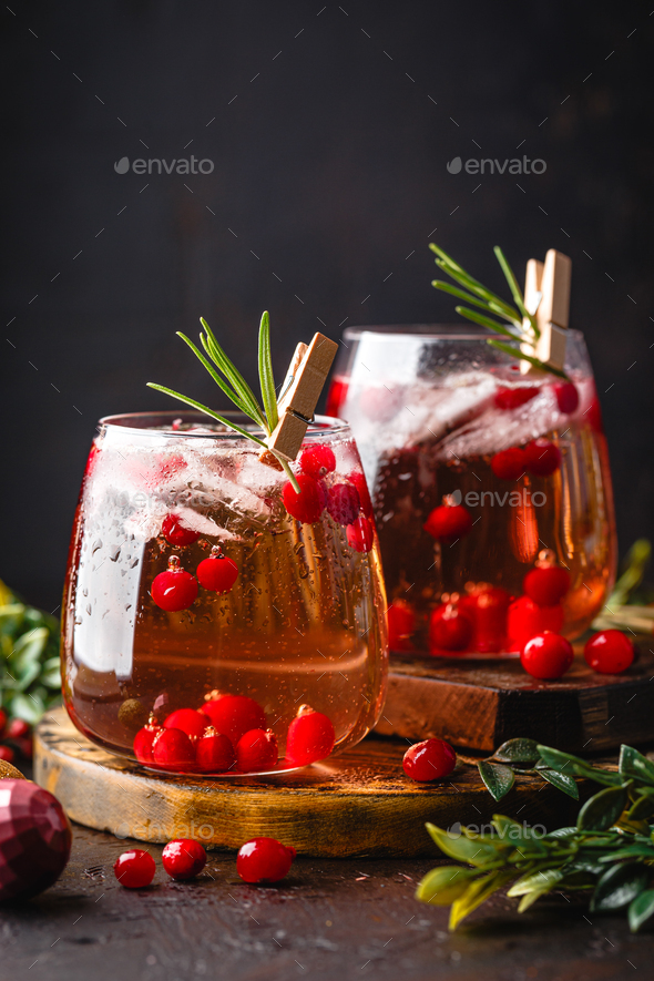 Festive Cranberry and rosemary cocktail with ice. Alcoholic or non-alcoholic cocktail - Stock Photo - Images