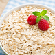 Oatmeal porridge with berries. Raspberries and blueberries. - PhotoDune Item for Sale