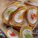 Close-up view of Thai crispy crêpes with sweet cream and colorful topping - PhotoDune Item for Sale