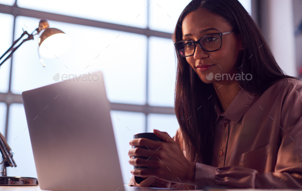 Businesswoman Working On Laptop At Desk In Modern Office - Stock Photo - Images