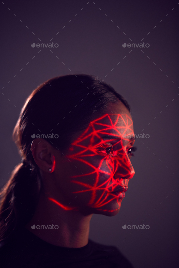 Facial Recognition Technology Concept As Woman Has Red Grid Projected Onto Face In Studio - Stock Photo - Images