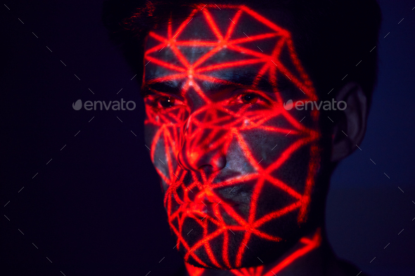 Facial Recognition Technology Concept As Man Has Red Grid Projected Onto Face In Studio - Stock Photo - Images