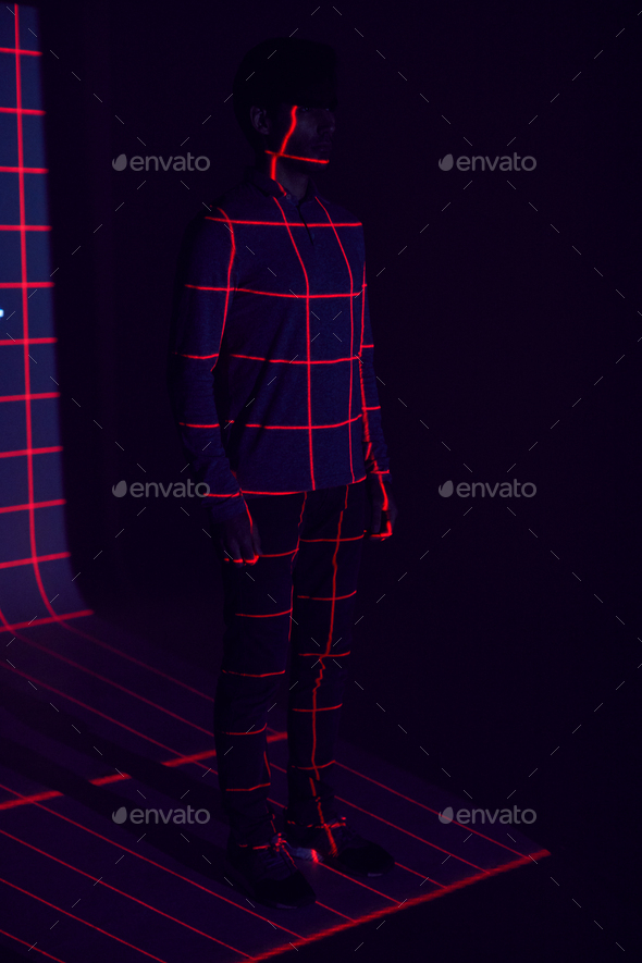 Facial Recognition Technology Concept As Man Has Red Grid Projected Onto Body In Studio - Stock Photo - Images