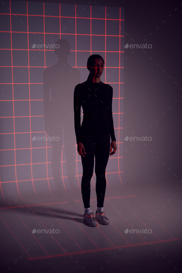 Facial Recognition Technology Concept As Woman Has Red Grid Projected Onto Body In Studio - Stock Photo - Images