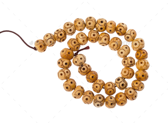 Spiral String Of Carved Bone Beads Isolated Stock Photo By Vvoennyy