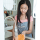 Portrait of asian teen girl doing household chores washing dishes in kitchen sink - PhotoDune Item for Sale
